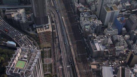 Aerial Metropolis view Shinkansen TGV Bullet train motion city skyscrapers Expressway Tokyo travel Japan Asia