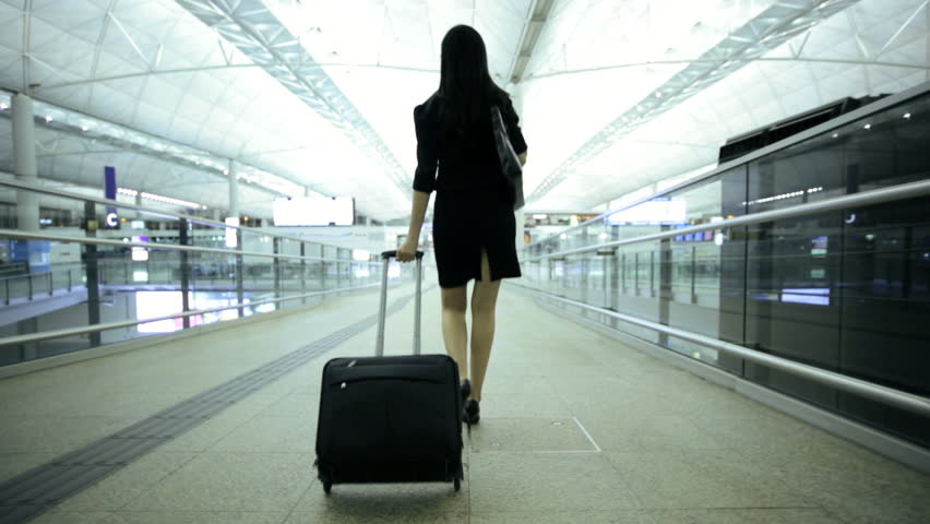 American Asian Chinese woman airport passenger travel business meeting information departures luggage executive traveller airline | Shutterstock HD Video #7810564
