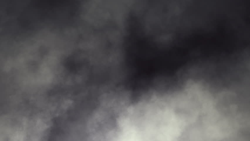 Dark swirling smoky clouds looping animation