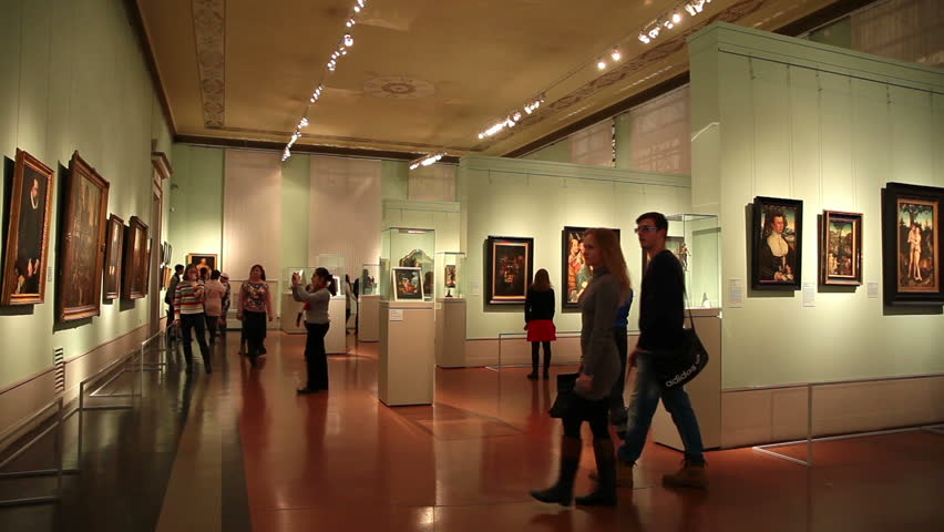 MOSCOW, RUSSIA - November 3, 2014: Visitors admire the works of art at the Pushkin Museum of Fine Arts.