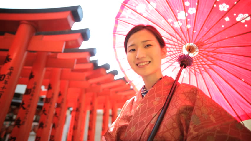 Smiling Asian Japanese girl red kimono parasol tourism travel advertisement garden wooden temple symbols Japan slow motion | Shutterstock HD Video #7836196
