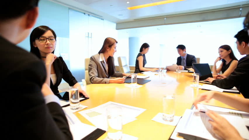 Ethnic Asian Chinese smart businessmen businesswomen corporate management China conference meeting wireless laptop device planning | Shutterstock HD Video #7852036