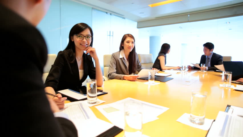 Asian Chinese male female business executives consultants city boardroom meeting teamwork communication conference wireless device | Shutterstock HD Video #7852144