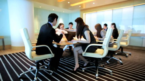 Young team ambitious male female Asian Chinese financial business global communication wireless technology boardroom meeting
