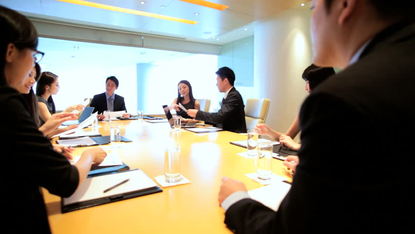 Successful team young Asian Chinese American business finance consultants boardroom conference wireless computer technology device | Shutterstock HD Video #7852234