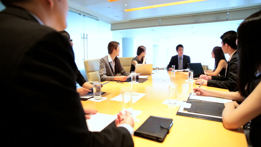 Young team ambitious male female Asian Chinese financial business global communication wireless technology Asia boardroom meeting | Shutterstock HD Video #7852264