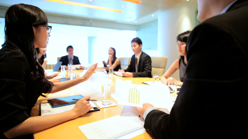 Successful team young Asian Chinese American business finance consultants boardroom conference wireless computer technology device | Shutterstock HD Video #7852267