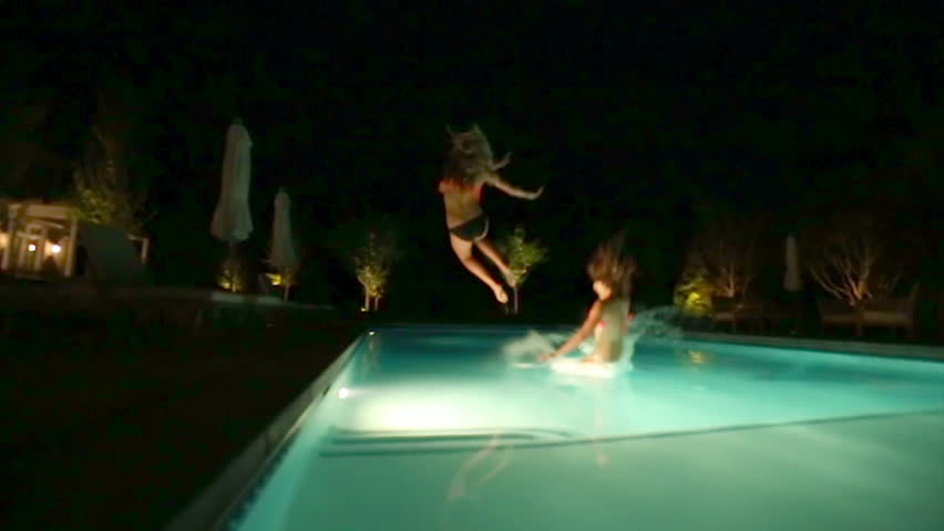 Teen Friends Have A Fun Chicken Fight At A Pool Party, Girls Cheer Them On In The -1215