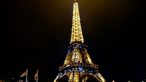 PARIS - DEC 31: Light Performance Show on December 31, 2013 in Paris, France. The Eiffel tower monument has 324 metres (1,063 ft) tall. It was built in 1889 with attendance over 7 millions people.