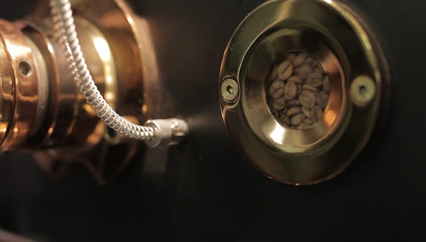 The freshly roasted coffee beans from a large coffee roaster.