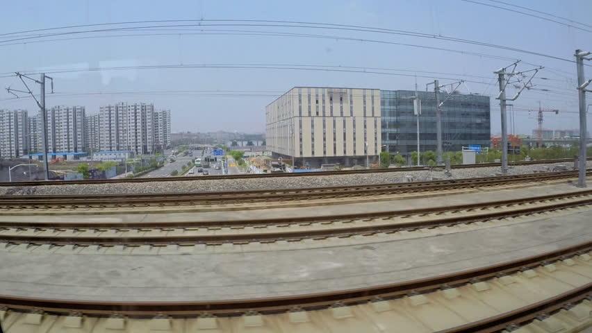 China - May 2014: Shanghai train in motion transport passing TGV Bullet train Urban scene East China Asia