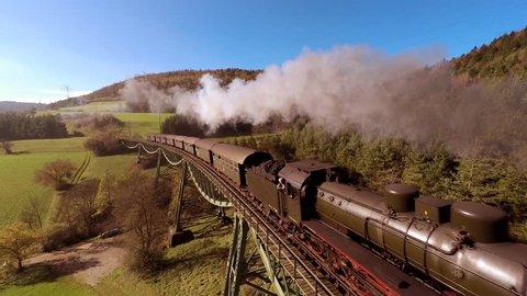 flying over steam train locomotive. vintage retro background