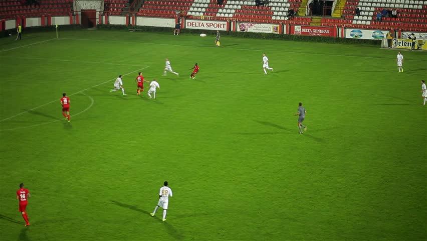 Srbija, Krusevac, 2014. FC Napredak - FC Radnicki. GOAL. Football. Soccer. Action. Shot. Goal. Score. Celebration. Two football clubs playing championship derby match. Soccer teams have a game. 30 fps