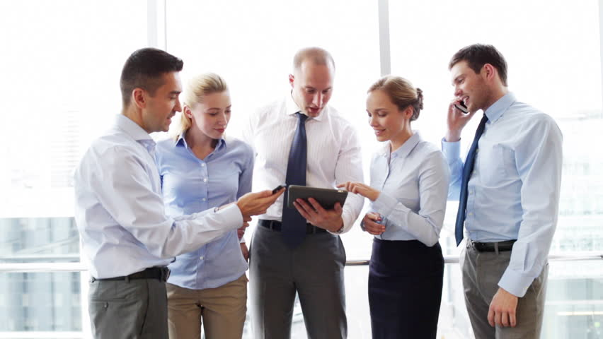 Business, teamwork, people and technology concept - business team with tablet pc and smartphones meeting in office | Shutterstock HD Video #7902130