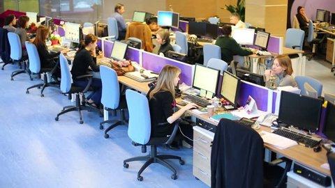 MOSCOW, RUSSIA - MAR 5, 2013: Staff work in modern office of RIA Novosti russian news agency