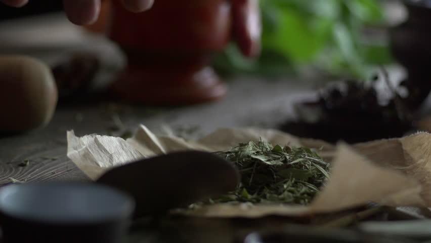 Stock video footage herbal medicine quacksalver prepares a potion slow motion