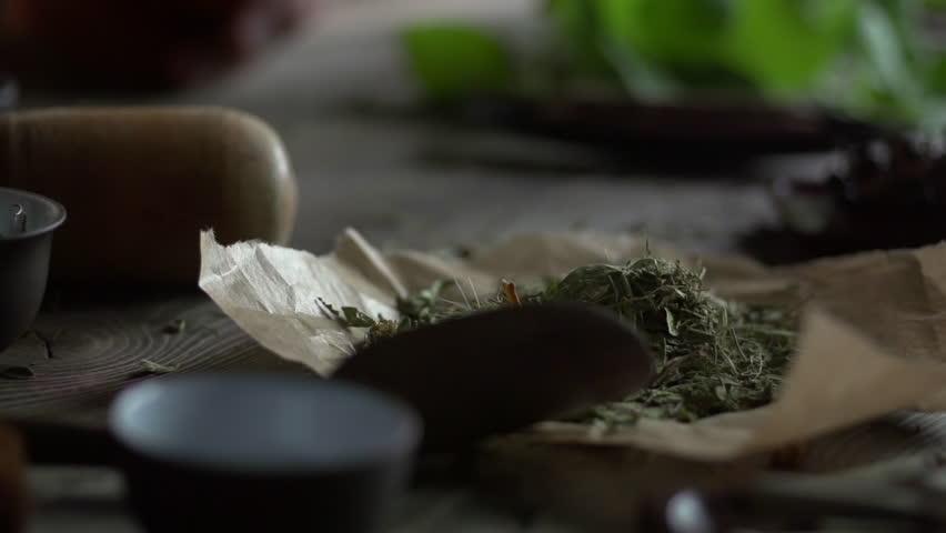 Stock video footage herbal medicine quacksalver prepares a potion slow motion | Shutterstock HD Video #7940854