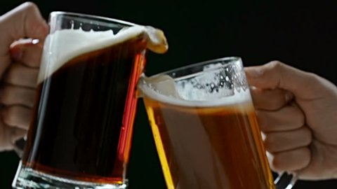 Two beer mugs clinked in toast