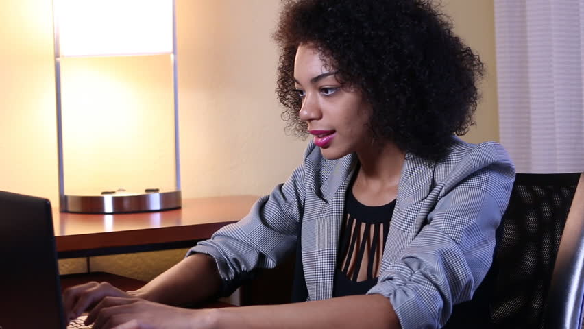 Ethnic businesswoman showing frustration working on laptop computer in office