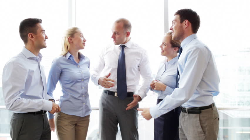 Business, teamwork, people and technology concept - smiling business team meeting and talking in office | Shutterstock HD Video #7982194