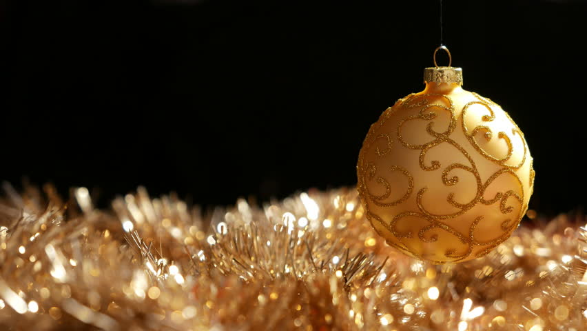 christmas gold ball spinning above stock footage video 100 royalty free 8010304 shutterstock - Black And Gold Christmas Ornaments
