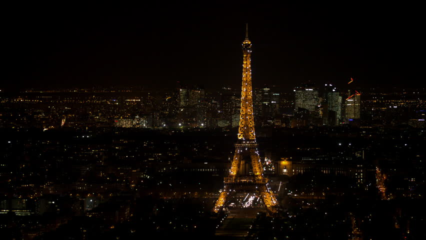 paris 26th november aerial view of the eiffel tower and la defense at night a birds eye. Black Bedroom Furniture Sets. Home Design Ideas