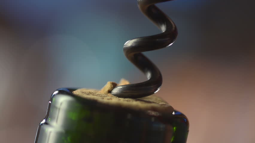 Stock video footage restaurant corkscrew to open a bottle close up