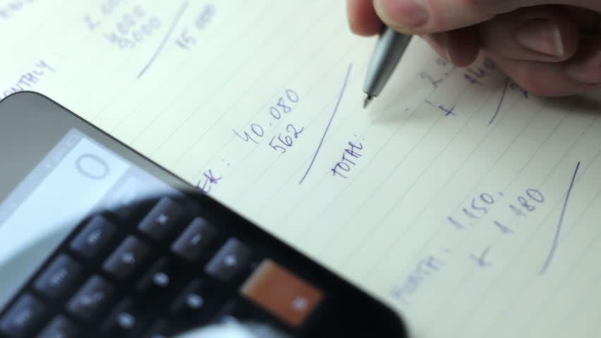 Businesswoman working, writing and calculating | Shutterstock HD Video #8097184
