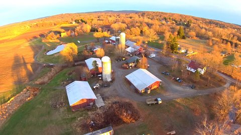 Working farm aerials, float over farm.  Upstate New York. Float over differt views of farm, in late afternoon late fall light, very clear light. Aerial Farm views, HD 60FPS close up and personal.