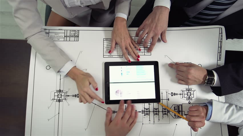 Dolly-in from above of business team of four discussing project | Shutterstock HD Video #8117614