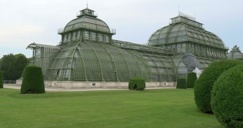 The Palm House and beautiful gardens nearby in Schonbrunn Palace, Vienna, Austria. The Palm House consists of three pailions for different climatic zones