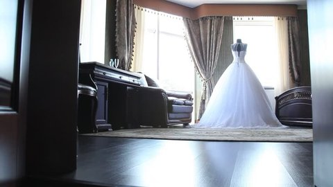 Wedding dress, offer, hotel, doors open, hitting the camera