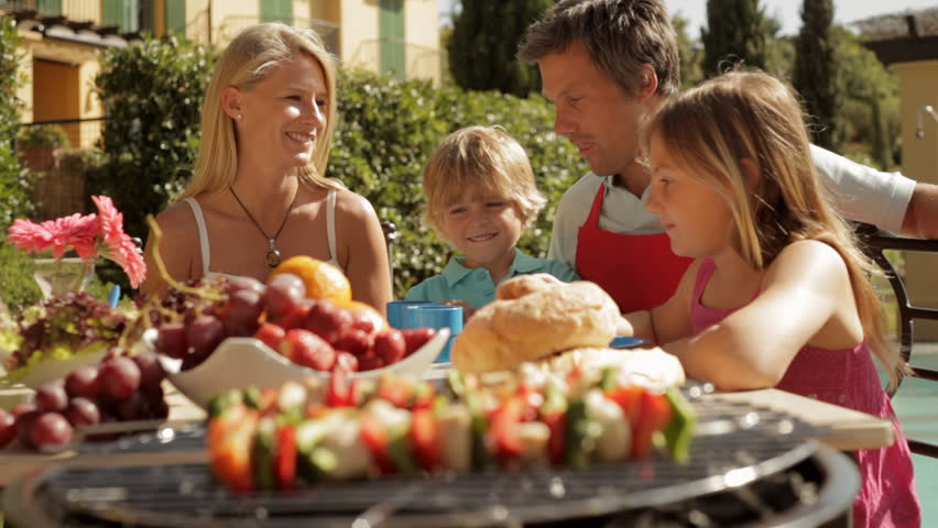 Dolly Shot Of Family Barbecue