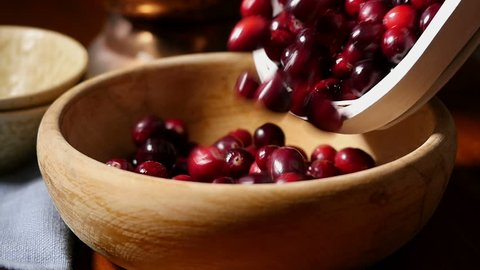 Pouring cranberries into bowl, slow motion