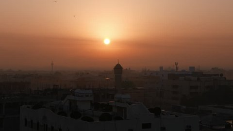 Middle East city view with mosque, Red Sky, Early Morning, Sun Rising, Birds passing (City of Dammam, Saudi Arabia)