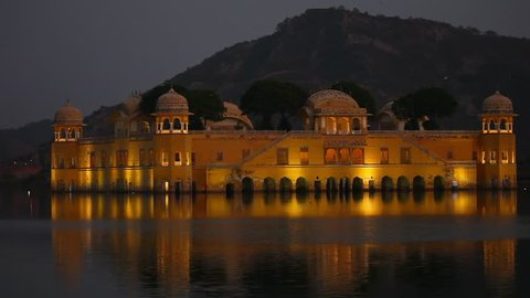 The palace Jal Mahal at dusk. Jal Mahal (Water Palace) was built in the middle of Man Sager Lake. Jaipur, Rajasthan, India.