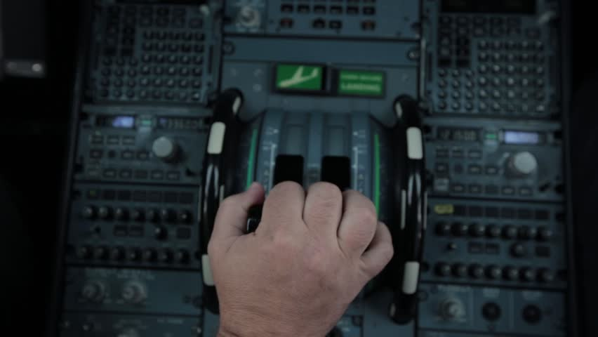 Cockpit cabin door inside. Hand of pilot push thrust lever handle for engine control takeoff Airbus A319 A320 A321