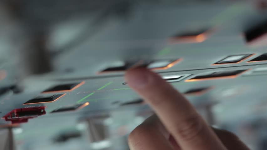 Glass cockpit door cabin flight deck. Hand pilots run gadget of aircraft prepearing push button on Airbus A319 A320 A321 | Shutterstock HD Video #8259256
