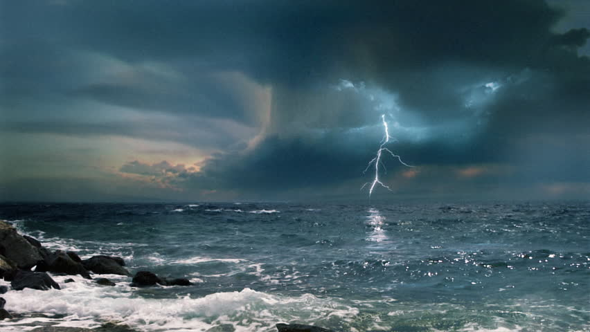Cinematic Storm Clouds With Lightning Strikes Reflecting In Ocean