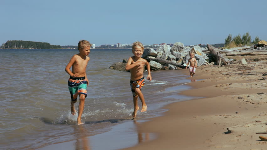 Three Happy Kids Run And Playing On Beach At The Day Time Stock Footage Video 8266654