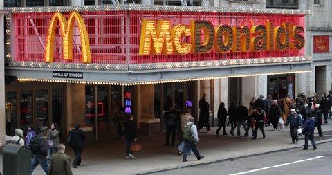 NEW YORK CITY, USA - APRIL 23, 2013 The Famous McDonald's Restaurant Fast Food Morning Breakfast People Walk Sidewalk Commuters ( Ultra High Definition, UltraHD, Ultra HD, UHD, 4K, 2160P, 4096x2160 )