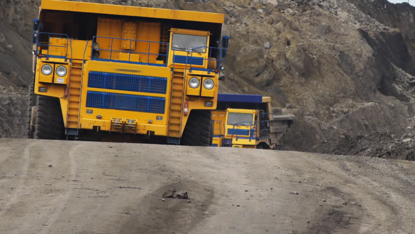 Off-road dump truck in the open pit mine