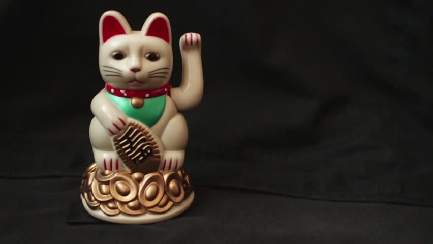 """LUCKY ASIAN WAVING CAT - 60fps slow motion dolly with waving cat on left; dolly left and back again to settle on cat  // Maneki-neko """"Beckoning Cat"""", popular in Asia as a symbol of luck and wealth."""