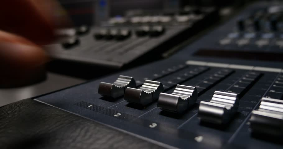 4K footage of a recording studio´s audio console and a hand pulling up the knobs/The audio console | Shutterstock HD Video #8376244
