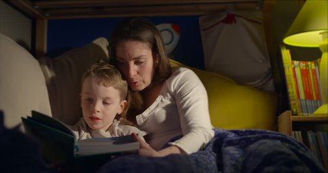 Bedtime story reading mum and 7 year old son