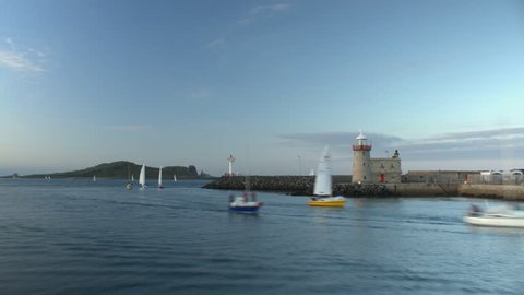 Timelapse of Sailing Boats passing Howth Harbour Lighthouse, Dublin, Ireland
