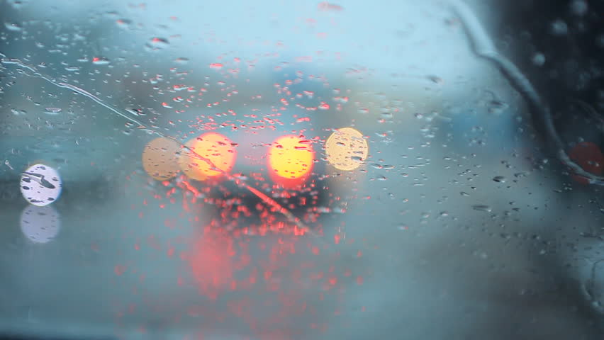 Bad weather, rain and wet snow on the evening dark road. Evening driving, Wet slippery road, rain drops and wet snow on the windshield.  Car headlights.  cars in motion. Traffic in poor visibility | Shutterstock HD Video #8434915