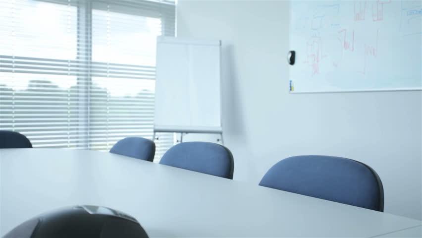 Modern corporation office prepared for a meeting | Shutterstock HD Video #8439370