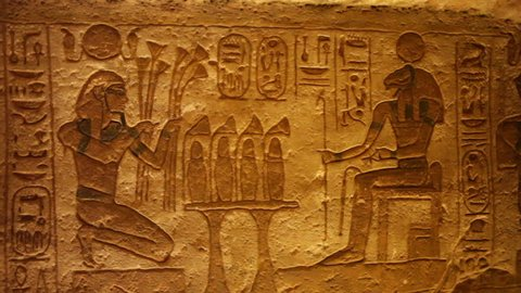 A wall of ancient Egyptian hieroglyphs inside 'The Great Temple' of Ramesses II. Located in Abu Simbel, Egypt. Wide pan. 1080p high definition.