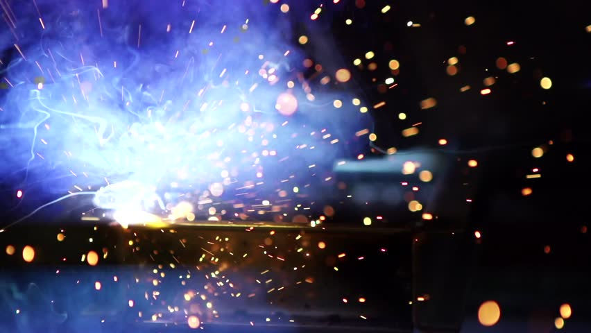 Flashes and lot of sparks from welding work at construction site in dark in slow motion | Shutterstock HD Video #8489200